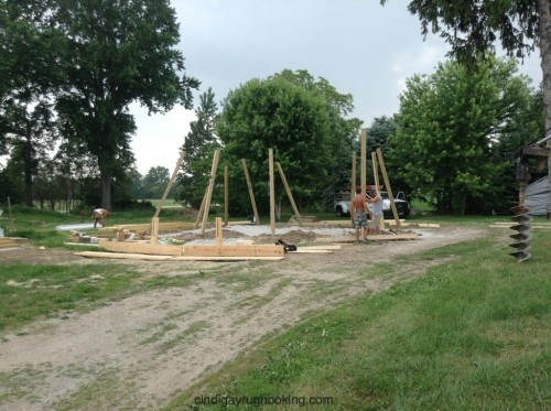 Poles for the pole barn are set in foundation holes